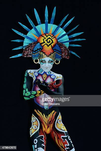 A participant poses with her body paintings designed by bodypainting artistGiovana Domingo Espadas from Spain in the 2015 World Bodypainting Festival...