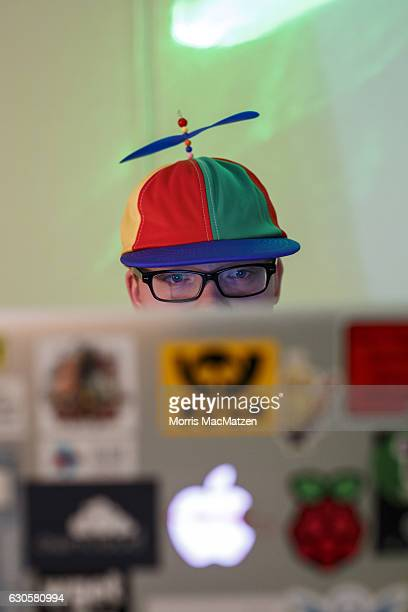 A participant poses with his laptop during the 33rd Chaos Communication Congress on its opening day on December 27 2016 in Hamburg Germany The annual...