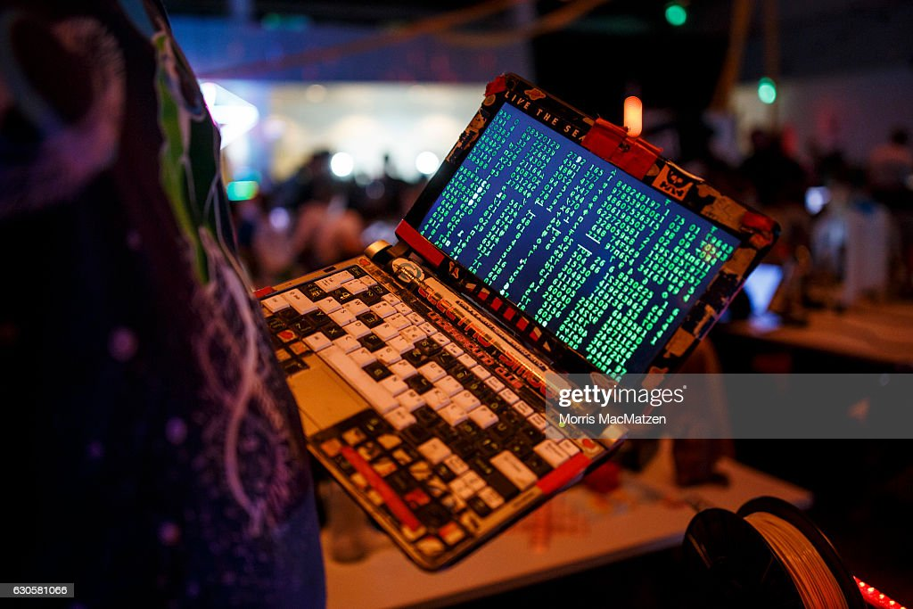 A participant poses with his laptop during the 33rd Chaos Communication Congress on its opening day on December 27, 2016 in Hamburg, Germany. The annual event is bringing together 12,000 computer hackers and activists who will meet over the next four days to share expertise and discuss topics related to the society and the digital world.
