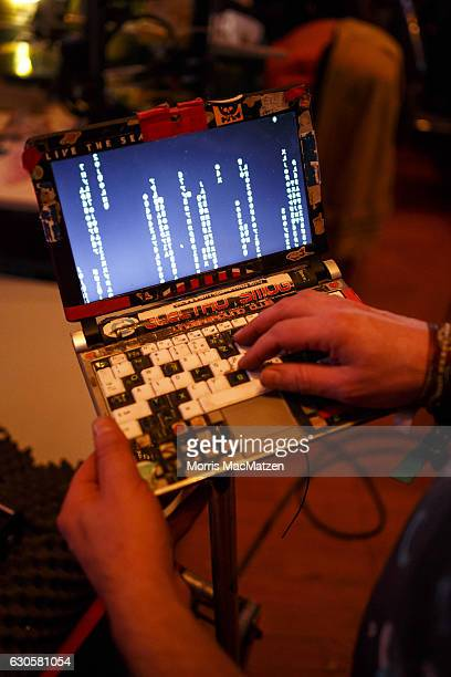 A participant poses with his laptop next to his 3D printer during the 33rd Chaos Communication Congress on its opening day on December 27 2016 in...