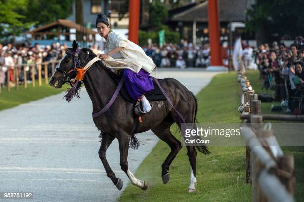 A participant rides a horse towards Kamigamo shrine during the Aoi Festival on May 15 2018 in Kyoto Japan Aoi Festival is one of the three main...