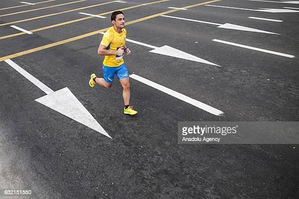 A participant runs as he takes parts in the Standard Chartered Dubai Marathon 2017 in Dubai United Arab Emirates on January 20 2017