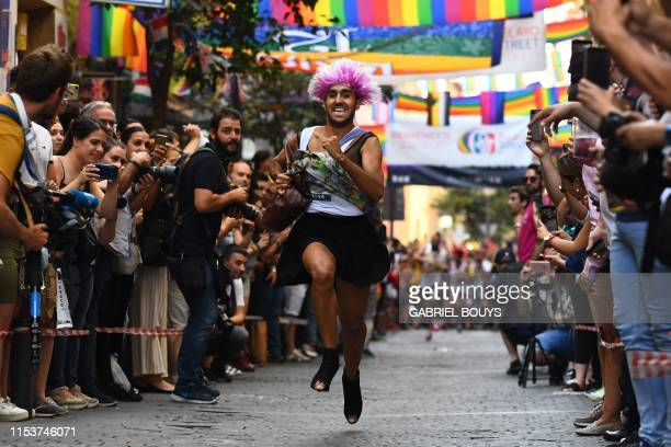 A participant runs during a highheel race as part of Gay Pride month in the neighbourhood of Chueca in Madrid on July 4 2019