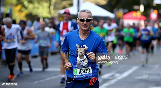 A participant runs during the 2016 New York City Marathon which starts from Staten Island continues through Brooklyn Queens Bronx regions and...