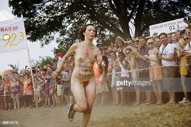 A participant runs in the annual Naked Run in the camp site at the Roskilde Festival southwest of Copenhagen on July 4 2009 AFP PHOTO / Anders Birch...
