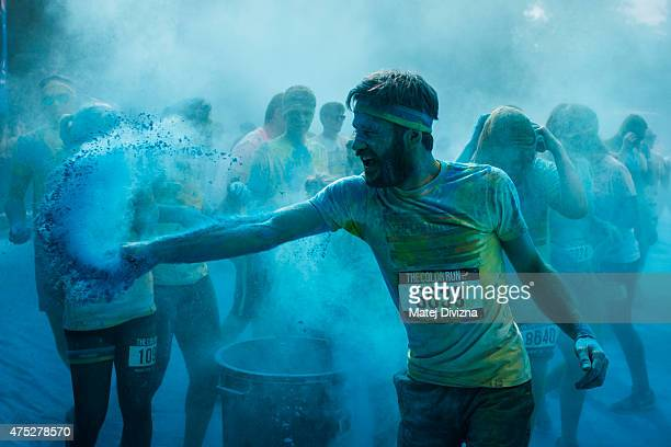 A participant runs through coloured powder as he takes part in the Color Run on May 30 2015 in Prague Czech Republic Around 12000 people attended the...