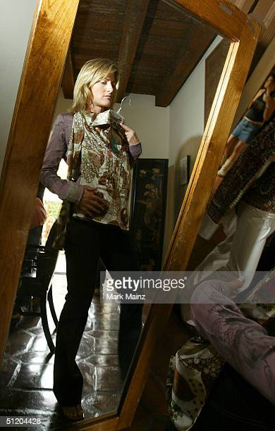 A participant samples the fasions at the Nina Morris Trunk Show at Patric Reeves' home August 21 2004 in Los Feliz California