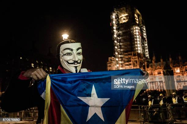 A participant seen carrying the Catalan independence flag while wearing the Guy Fawkes mask Demonstrators attend the Annual Million Mask March...
