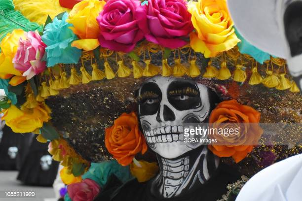 A participant seen dressed as the dead during the parade People take part at the annual Day of the Dead Parade as part of the celebrations of...