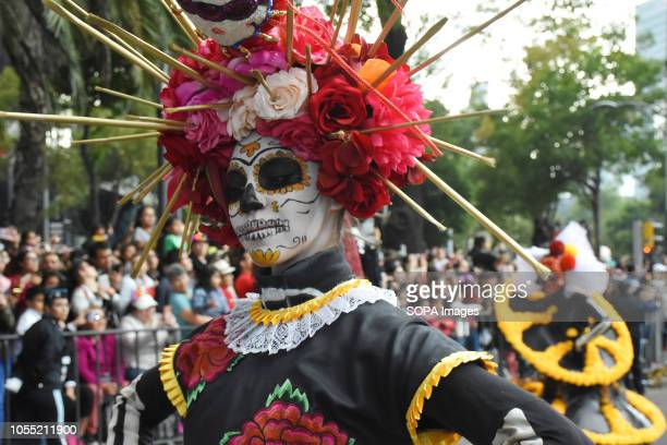 A participant seen dressed up as the dead during the event People take part at the annual Day of the Dead Parade as part of the celebrations of...
