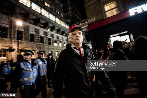 A participant seen dressing up as United States president Donald Trump during the march Demonstrators attend the Annual Million Mask March bonfire...