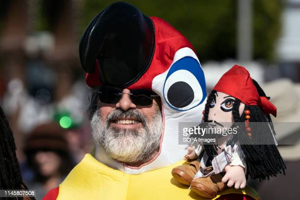 Participant seen during the parade in Los Angeles. Mardi Gras also known as Fat Tuesday is a cultural Carnival that is celebrated throughout Latin...