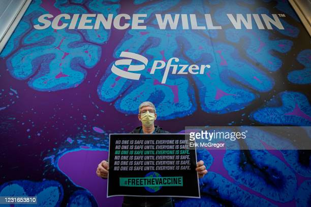 Participant seen holding a sign at the protest. A coalition of healthcare advocacy community organizations gathered outside Pfizer Worldwide...