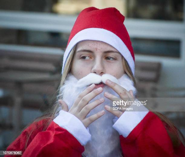 A participant seen preparing before a race during the annual Santa Run Hundreds of people attend the annual Santa Run