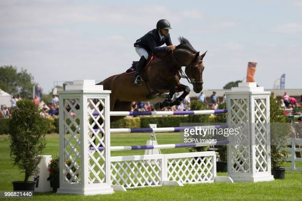 A participant seen riding a horse while jumping over an obstacle during the Great Yorkshire Show 2018 on day one The Great Yorkshire Show is the...
