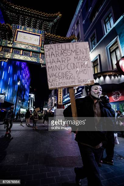 A participant seen walking through the Chinatown in London Demonstrators attend the Annual Million Mask March bonfire night protest advertised as a...