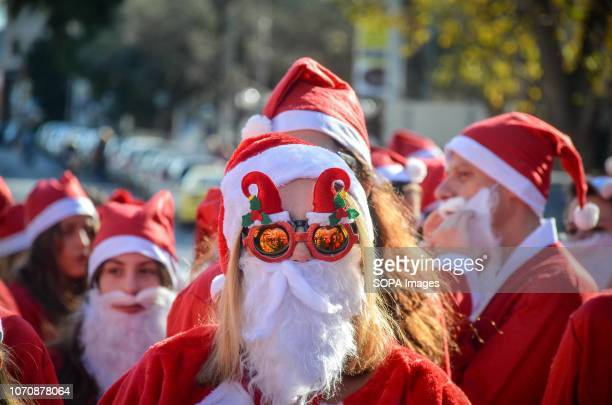 A participant seen wearing Christmas glasses during the annual Santa Run Hundreds of people attend the annual Santa Run