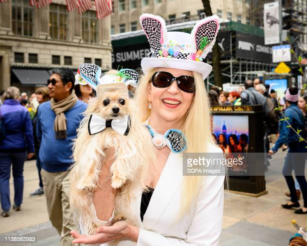 A participant seen with a dog in a fancy costume during the Easter Bonnet parade on Fifth Avenue in midtown Manhattan in New York City