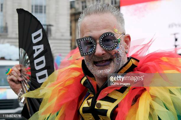 S LONDON GREATER LONDON UNITED KINGDOM A participant seen with rainbow feathers during the parade Thousands of revellers filled Londons streets with...