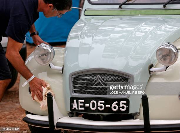 Participant shines his Citroen classic car 2CV before the parade at Ericeira village during the World 2017 2CV Meeting July 30, 2017. - The event is...