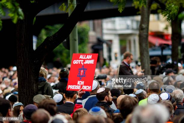 A participant shows a banner during a wear a kippah gathering to protest against antiSemitism in front of the Jewish Community House on April 25 2018...