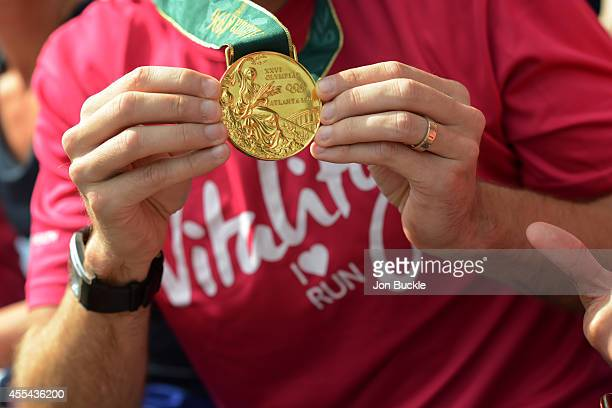 Participant shows off Sir Steve Redgrave's Olympic Gold medal from the Atlanta Summer Games during the Laureus Oxford Half Marathon Training Day at...