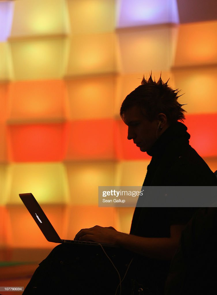 A participant sits with a laptop computer as he attends the annual Chaos Communication Congress of the Chaos Computer Club at the Berlin Congress Center on December 28, 2010 in Berlin, Germany. The Chaos Computer Club is Europe's biggest network of computer hackers and its annual congress draws up to 3,000 participants.