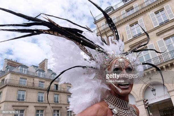 A participant smiles during the Paris Gay Pride Parade or known as Marche des Fiertés LGBT in France as they march through a street on June 24 2017...