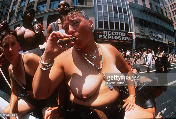 A participant smokes a cigar during the Gay Pride Parade June 27 1999 in New York City The Gay Pride Parade is organized for and on behalf of all...