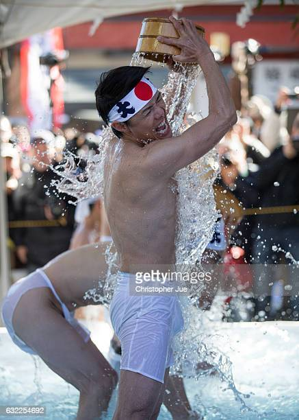 A participant splashes icecold water on himself during the ice water winter purification ceremony on January 21 2017 in Tokyo Japan At Daikoku...