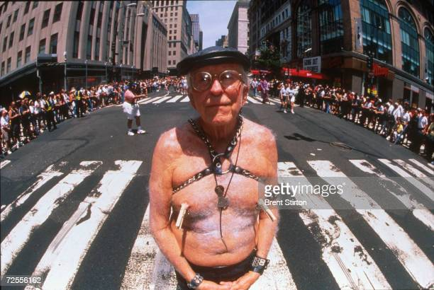 A participant stands in the street during the Gay Pride Parade June 27 1999 in New York City The Gay Pride Parade is organized for and on behalf of...
