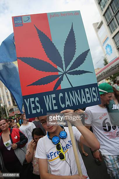 A participant supporting the legalization of marijuana marches in the annual Hemp Parade on August 9 2014 in Berlin Germany Supporters of cannabis...