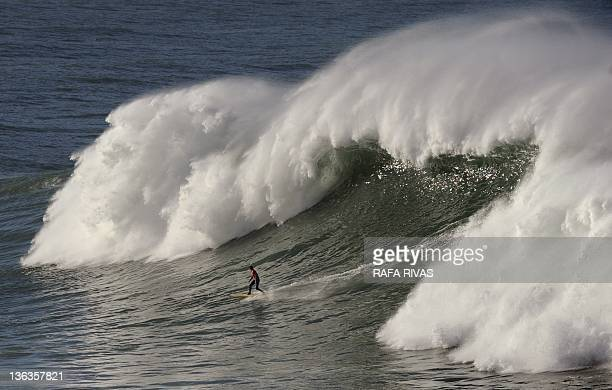 A participant surfs during the Punta Galea EVE Challenge on January 3 2012 in the Northern Spanish Basque town of Getxo 16 surfers took part during...