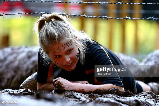 A participant tackles the Kiss of Mud during the 2016 Tough Mudder London South at Holmbush Farm on September 24 2016 in Horsham England