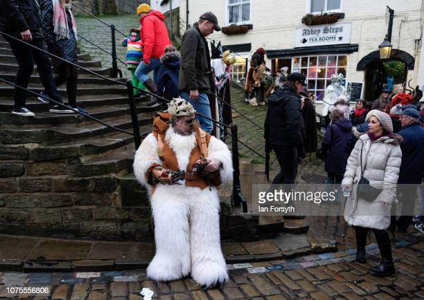 A participant takes a break ahead of the annual Whitby Krampus parade on December 01 2018 in Whitby England The Krampus is a horned anthropomorphic...