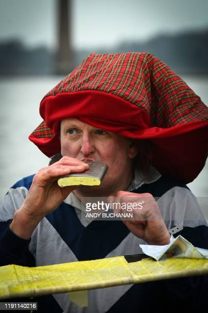 A participant takes a drink as he takes part in the annual New Year's Day Loony Dook swim in the Firth of Forth in South Queensferry near Edinburgh...