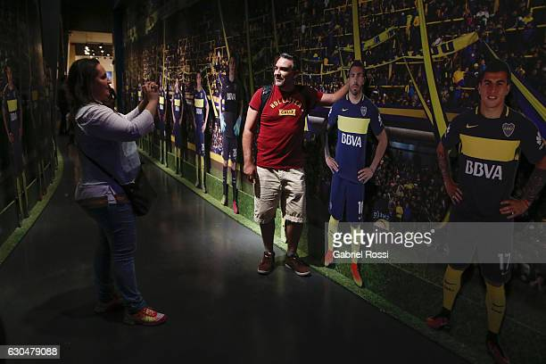 A participant takes a photo with a banner depicting the soccer player Carlos Tevez at Bombonera Museum in Boca Juniors Stadium during a 5 hour tour...