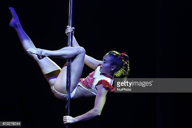 A participant takes part in a pole dancing competition during Poleart Greece on September 24 2016 in Athens Greece