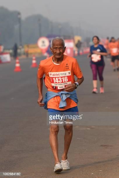 A participant takes part in the Airtel Delhi Half Marathon at Rajpath on October 21 2018 in New Delhi India Over 34000 marathoners are participating...