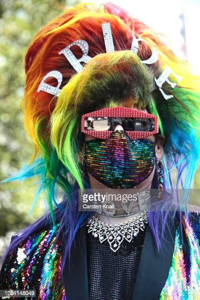 Participant takes part in the annual Christopher Street Day parade on July 24, 2021 in Berlin, Germany. The Christopher Street Day parade is held in...