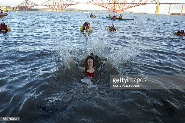 A participant takes part in the annual New Year's Day 'Loony Dook' swim in the Firth of Forth in South Queensferry near Edinburgh on January 1 2017...