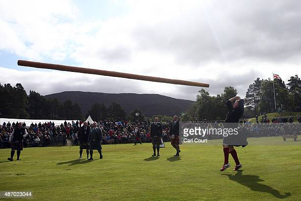 A participant takes part in the caber tossing competition at the Braemar Gathering on September 5 2015 in Braemar Scotland There has been an annual...
