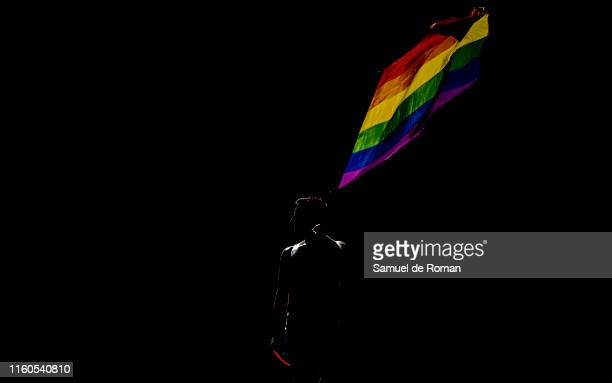 A participant takes part in the Gay and Lesbian Pride parade in the centre of Madrid on July 06 2019 in Madrid Spain