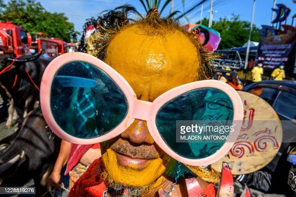 Participant takes part in the traditional parade before the annual Chonburi Buffalo Race in Chonburi on October 1, 2020.