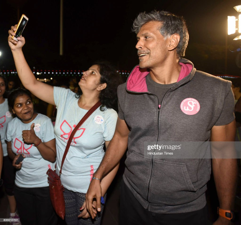A participant takes selfie with super model Milind Soman during the Colors Pinkathon Delhi, 'Fearless Midnight Women's run', organised at Inner Circle, Connaught Place, on August 18, 2017 in New Delhi, India. The run was not a protest or a fight, but through this midnight run, hundreds of women proved solidarity and fearlessness. 'Fearless' is an endeavour to help women to make a strong statement about their right to reclaim spaces.