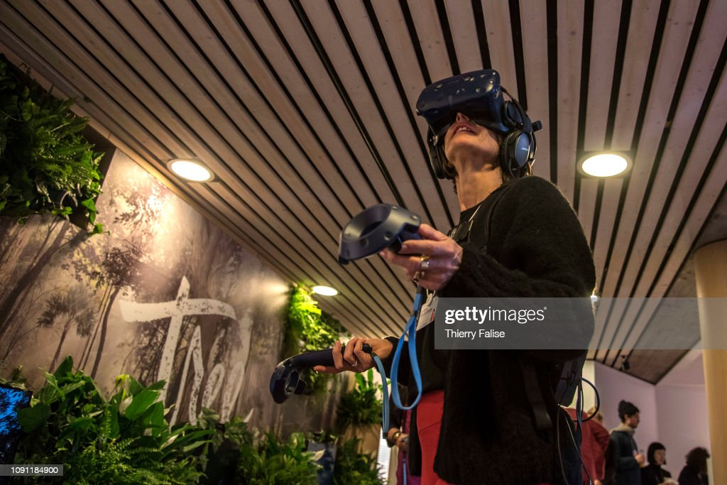 A participant tests the Tree VR at the 2019 World Economic