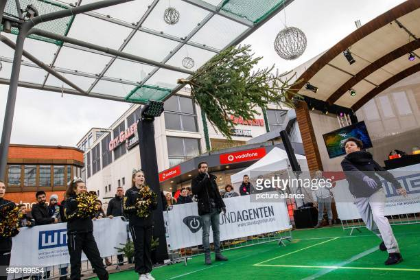 A participant throws a fir tree at the second Christmas Tree Long Throw Challenge to happen in Wolfsburg Germany 6 January 2018 Photo Philipp von...
