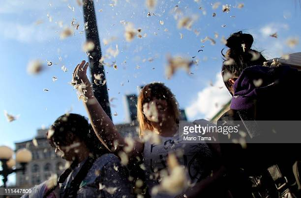 A participant tosses feathers in Manhattan's Union Square during a massive pillow fight on April 2 2011 in New York City Over 130 cities worldwide...