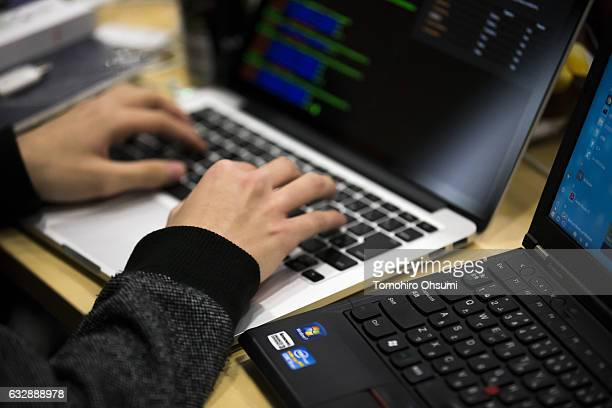 Participant uses a laptop computer as he takes part in the Seccon 2016 final competition on January 28, 2017 in Tokyo, Japan. 24 teams from Japan,...