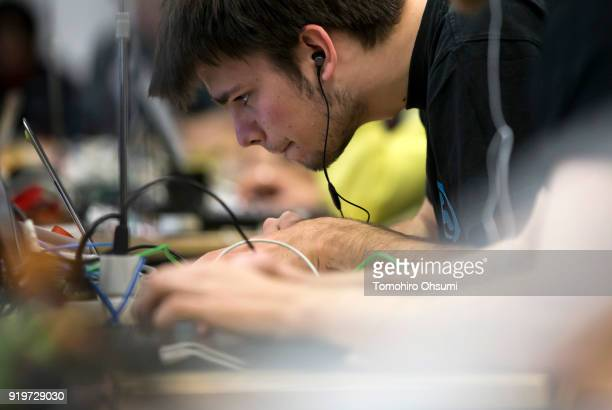 A participant uses a laptop computer as he takes part in the SECCON 2017 final competition on February 18 2018 in Tokyo Japan Fifteen teams from...